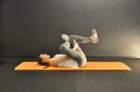 Stretching äußeres Gesäß Rückenlage